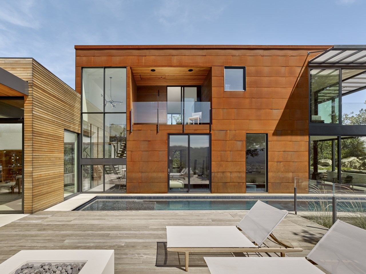 ​​​​​​​In contrast to the wood box that contains architecture, design, facade, home, house, timber cladding, pool, de Vito Architecture + Construction
