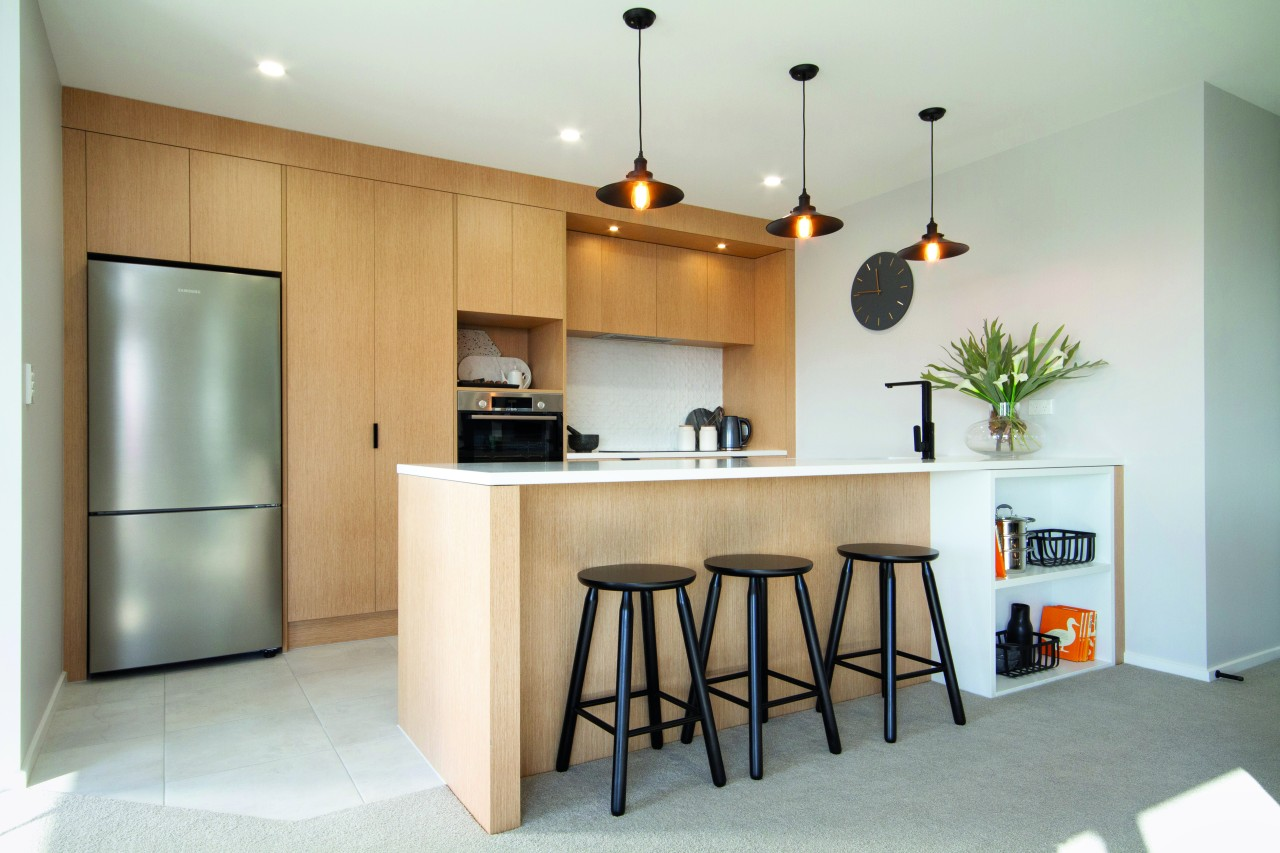 ​​​​​​​In this GJ Gardner Hamilton showhome, the modern architecture, cabinetry, countertop, benchtop, kitchen, home, house, interior design, GJ Gardner, showhome, cabinetry, timber