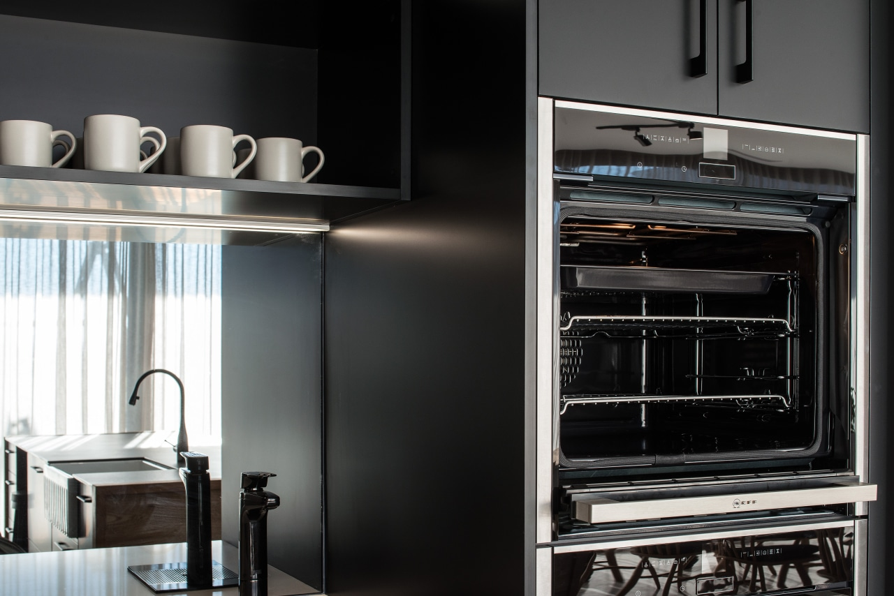 Black cabinetry by its nature can make a cabinetry, countertop, cupboard, door, interior design, kitchen, kitchen appliance, black, splashback, mirror, Impact kitchens