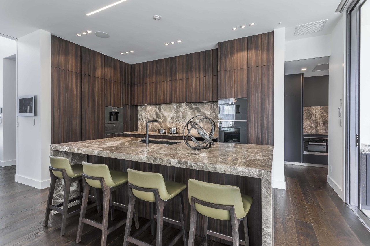 ​​​​​​​The rich Sienna marble seen on this kitchen's architecture, cabinetry, countertop, design, floor, flooring, furniture, hardwood, interior design, kitchen, wood flooring, Studio Italia