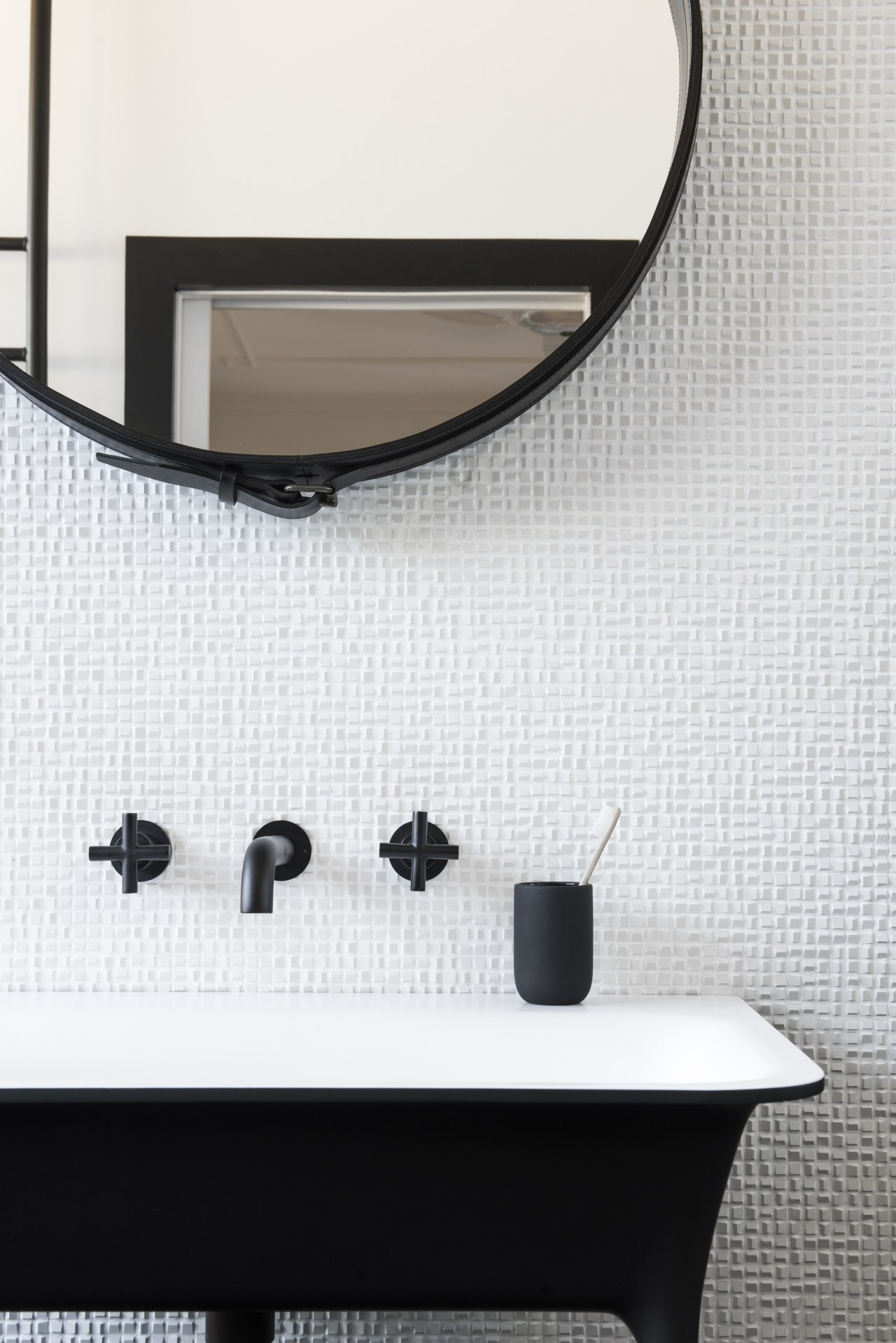​​​​​​​This contemporary, two-tone bathroom by Minosa benefits from bathroom, black, black-and-white, furniture, mirror, table, tile, wall, white, Minosa, Darren Genner