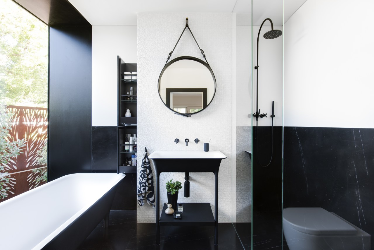 ​​​​​​​This contemporary bathroom, located in a modest space, architecture, bathroom, black, black-and-white, floor, plumbing fixture, sink, tap, tile, white, black, freestanding tub, round mirror, Minosa, Darren Genner
