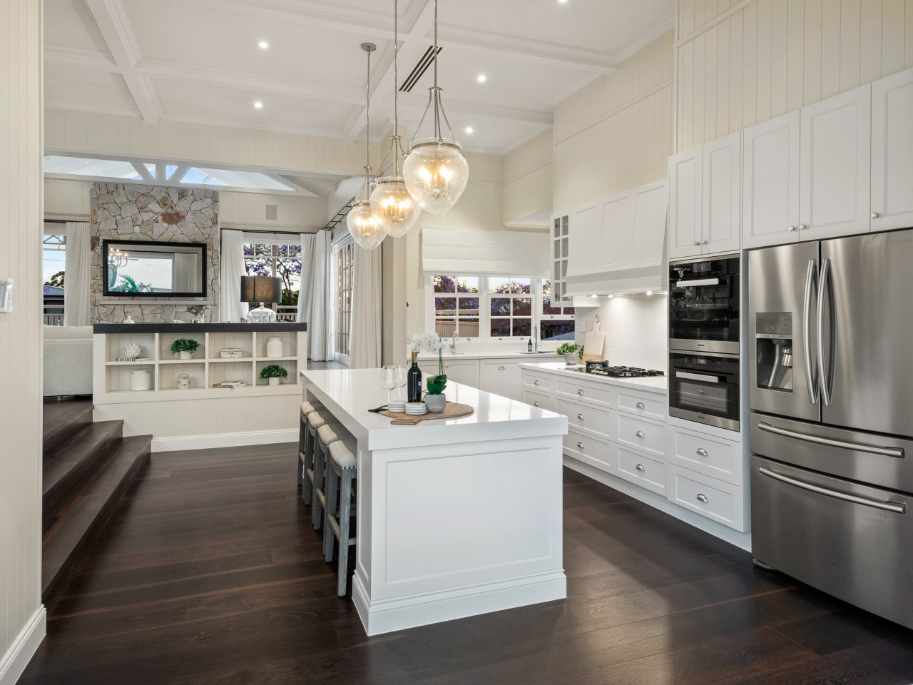 High, ornate ceilings and beadboard wall finishes in architecture, cabinetry, countertop, benchtop, timber floor, flooring, hardwood, interior design, kitchen, light fixture, lighting, refrigerator, wood, wood flooring, cabinetry, Baahouse + Baahouse Architecture