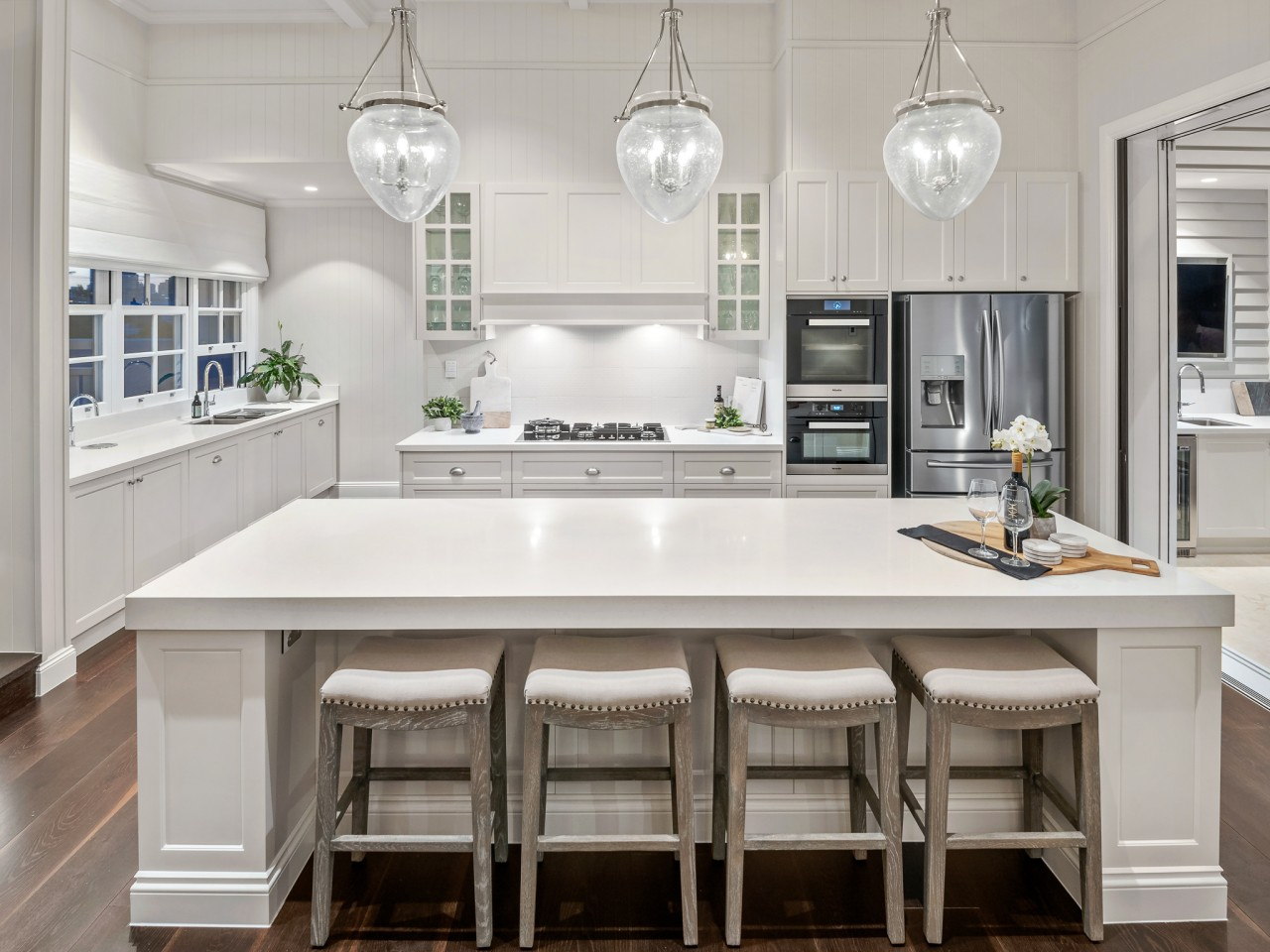 Given the level of detailing used in the architecture, bar stool, cabinetry, countertop, cupboard, timber flooring, furniture, hardwood, interior design, kitchen, light fixture, lighting, stool, white, wood flooring, Baahouse + Baahouse Architecture, Ceasarstone