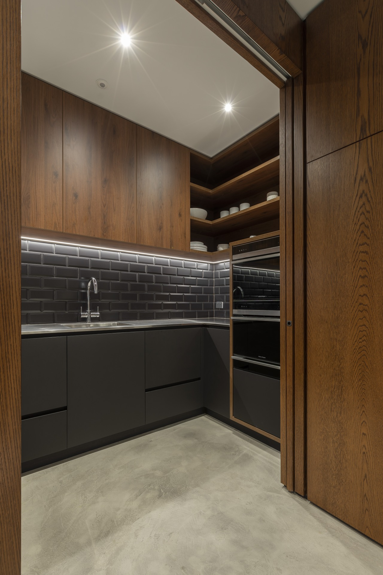 Double cavity slider doors in the same timber architecture, cabinetry, countertop, cupboard, floor, flooring, furniture, home, house, interior design, kitchen, sliding door,  cube dentro, scullery, appliances