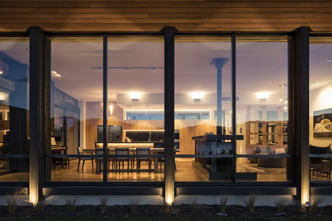 This doll's house view of a modern entertainer's architecture, building, windows, interior design, lighting, reflection, Eliska Lewis Architects