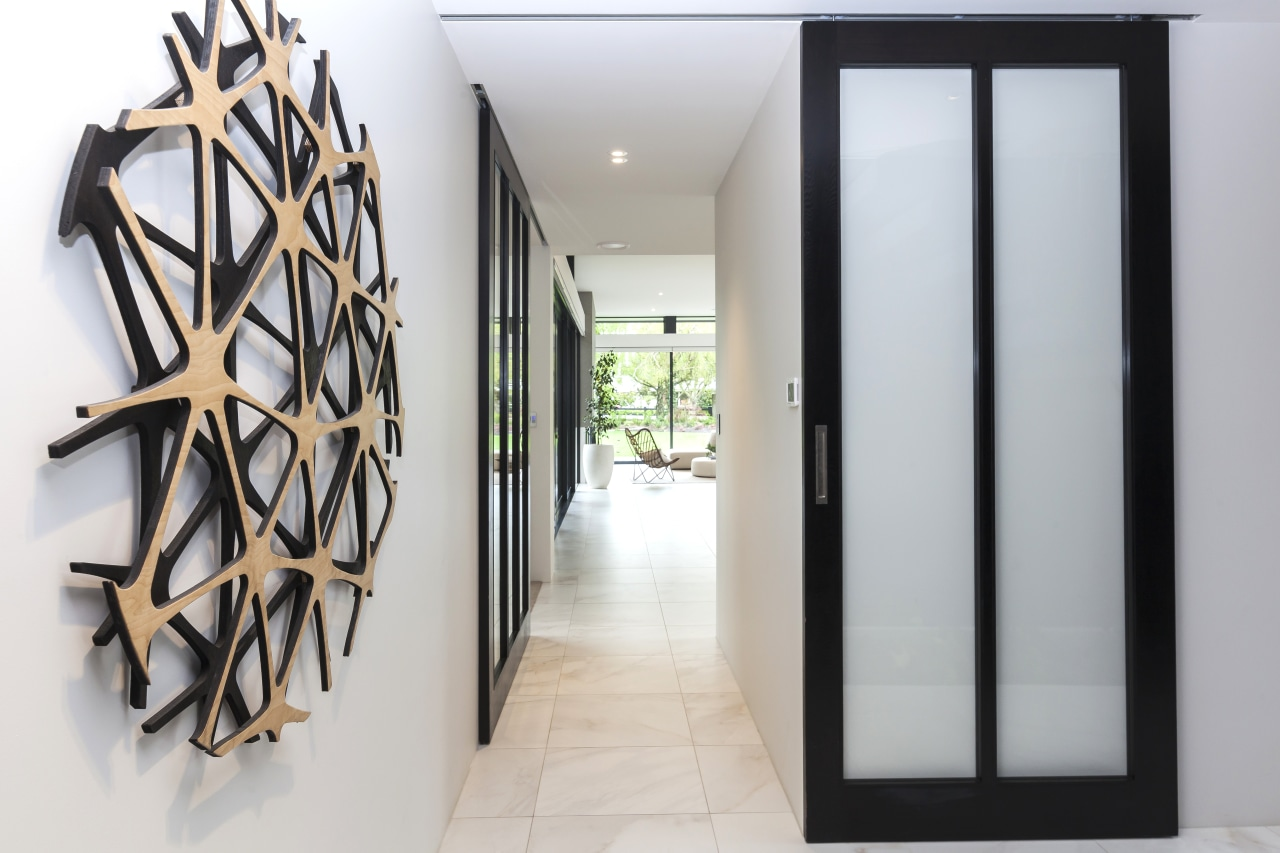 The entry to this home features serene shoji-like, architecture, door, interior design, entrance, shoji doors, wall sculpture, Don Service, O'Neil Architecture
