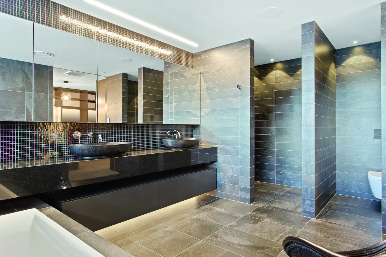 ​​​​​​​This atmospheric master ensuite includes the dark, shimmery architecture, master suite, bathroom, floor, flooring, furniture, glass, home, house, interior design, tile, wall, white, concealed lighting, glass mosaics, O'Neil Architecture
