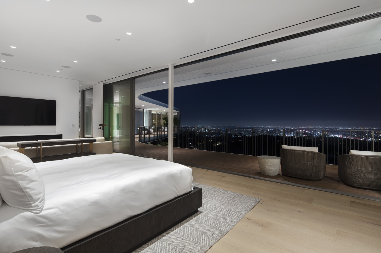 ​​​​​​​At night, large sliding glass panels open this home, house, architecture, bedroom, black-and-white, design, floor, flooring, furniture, home, house, interior design, lighting, open living, sliding glass panels, city views, spfa
