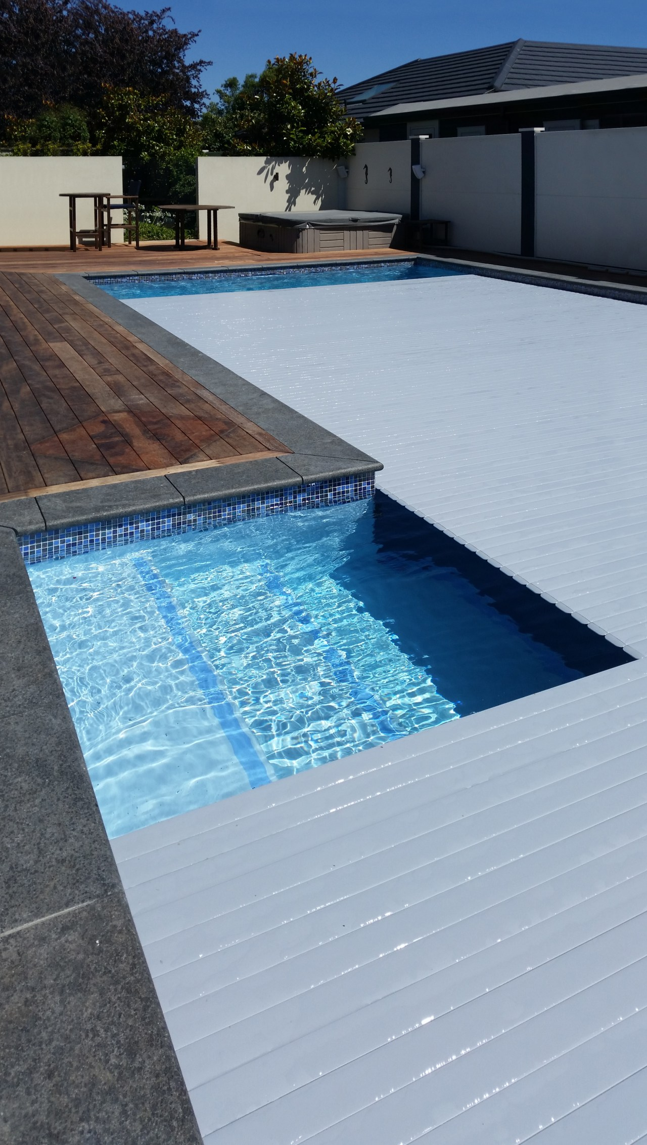​​​​​​​Roll Out Roll Under slatted covers are a architecture, composite material, floor, leisure, property, real estate, rectangle, swimming pool, tile, water, water feature, gray
