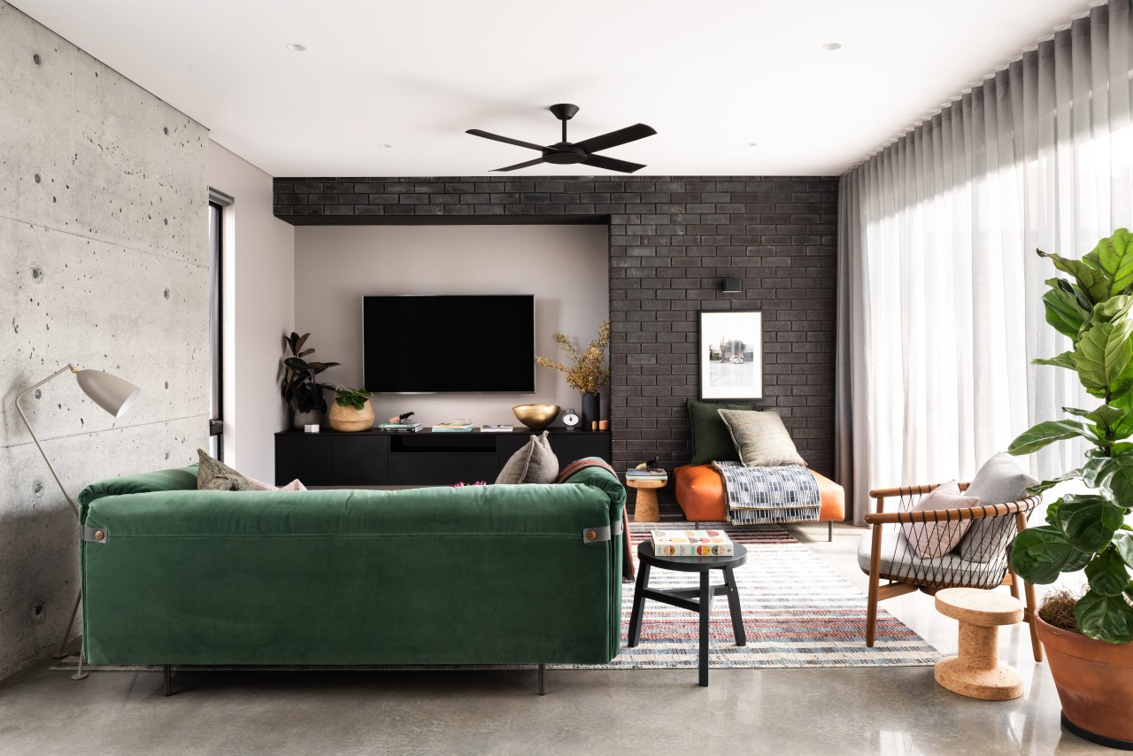 ​​​​​​​A feature cast-in-situ concrete wall with all imperfections architecture, coffee table, comfort, couch, design, floor, flooring, furniture, green, home, house, interior design, living room, passive heating, concrete wall, polished concrete floor, Dalecki Design