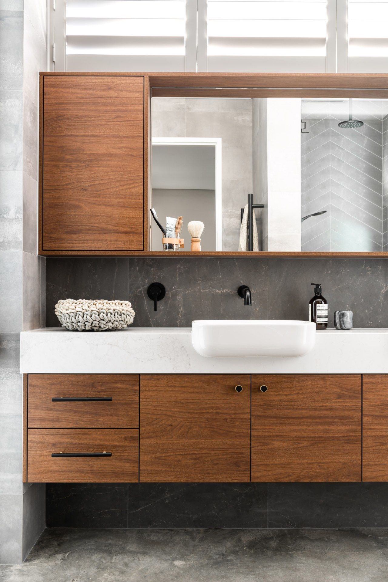 ​​​​​​​This master ensuite has a luxury aesthetic with architecture, bathroom, bathroom accessory, bathroom cabinet, cabinetry, ensuite, countertop, drawer, floor, plumbing fixture, sink, tap, tile, white, vanity, luxury, Dalecki Design