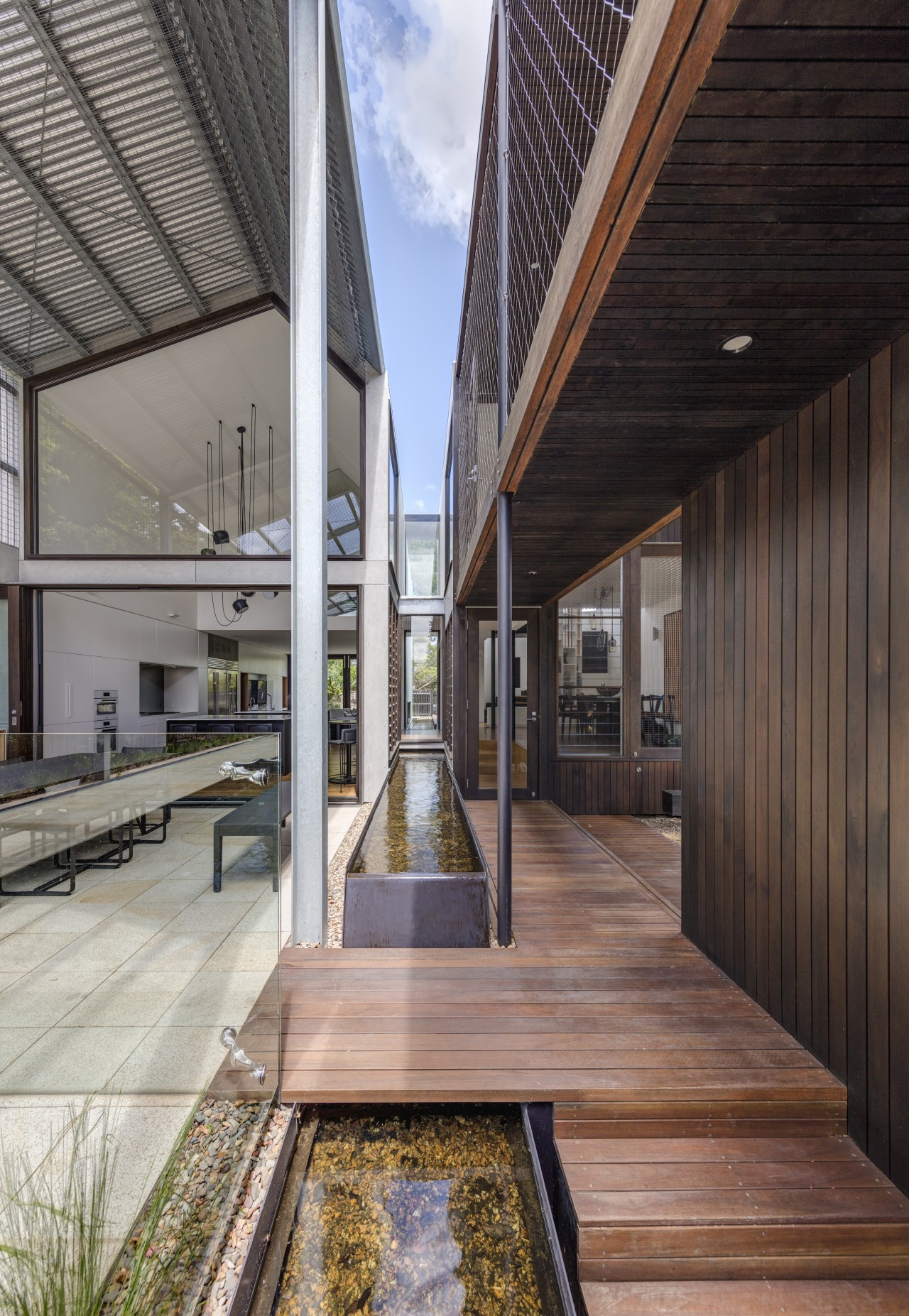 While the water running between the two wings home, architecture, courtyard, facade, home, house, interior design, two wing home, CplusC Architectural Workshop