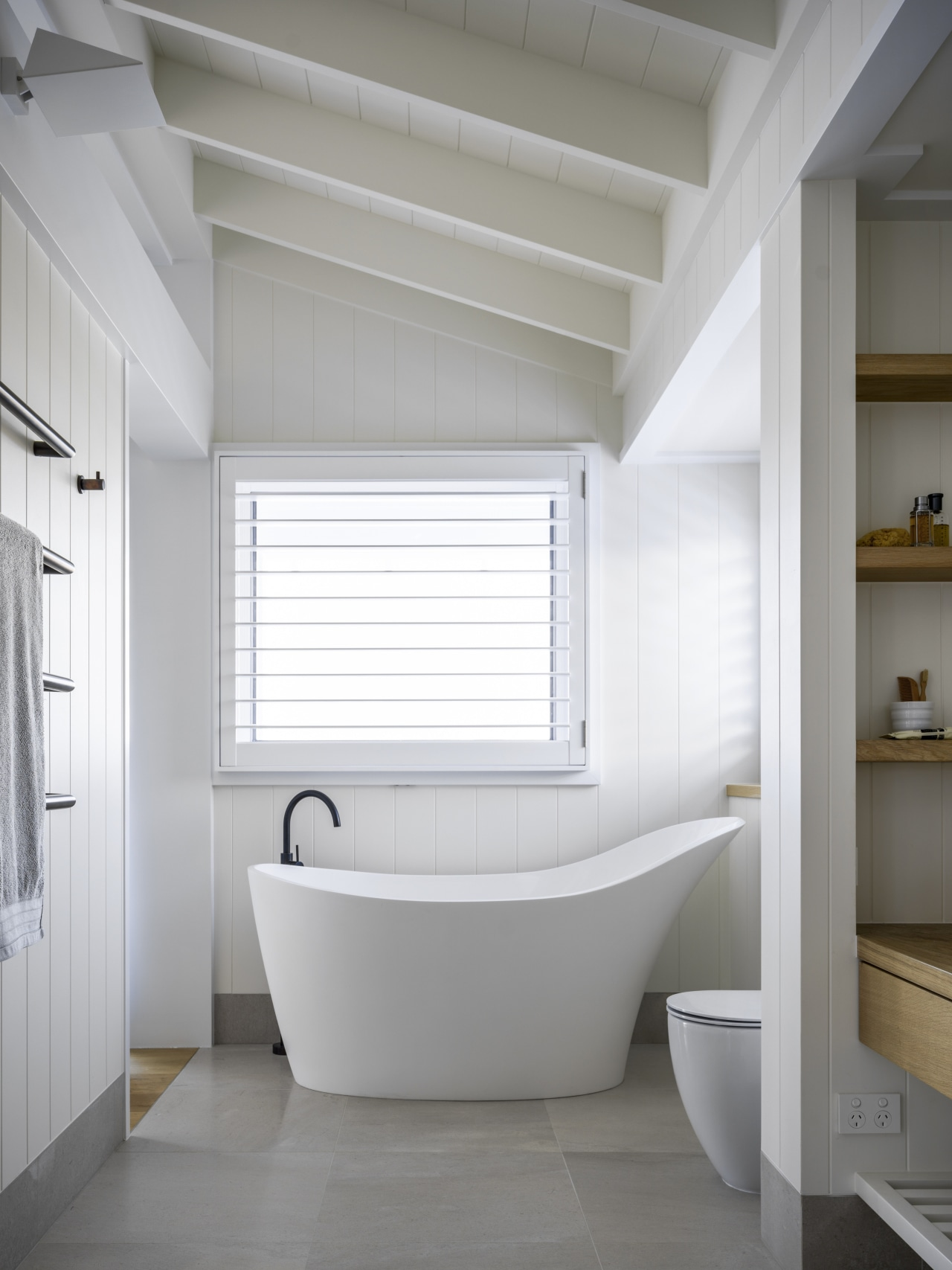 ​​​​​​​The aptly named slipper bath provides a focal architecture, bathroom, bathtub, slipper bath, ensuite, white weatherboard finish, hamptons style