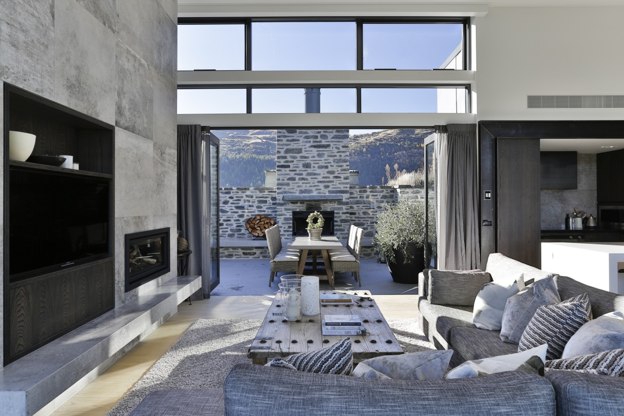 ​​​​​​​On this Arrowtown home, substantial bifold doors let home, architecture, design, floor, furniture, home, house, interior design, living room, table, wall, Koia Architects, Bifold doors