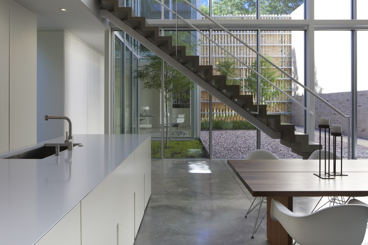 ​​​​​​​A concrete staircase appears to float within a architecture, building, ceiling, daylighting, design, floor, flooring, furniture, glass, handrail, home, house, interior design, loft, material property, metal, office, property, real estate, room, stairs, table, tile, wall, window, gray