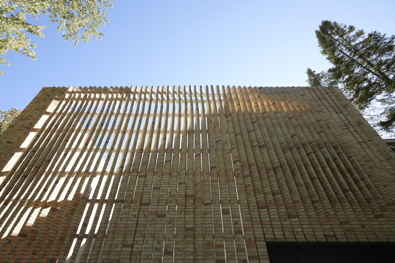 Twisting brick columns on the front facade of architecture, building, facade, house, reinforced concrete, sky, tree, brown, teal