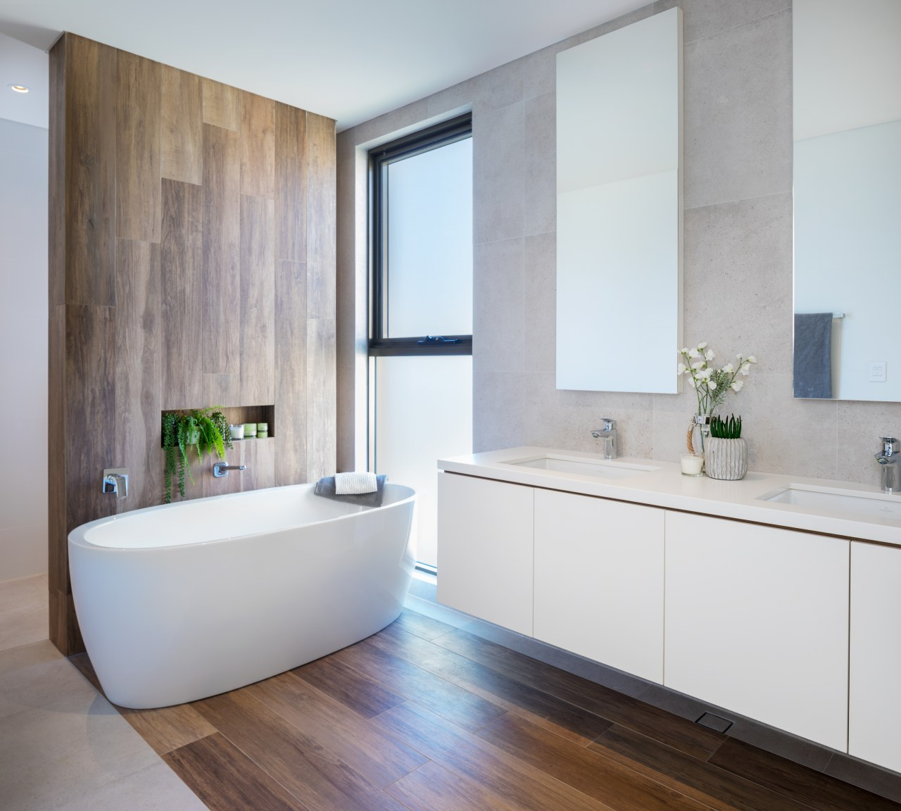 This bathroom continues the use of natural materials architecture, bathroom, bathroom accessory, bathroom cabinet, bathtub, beige, building, cabinetry, ceiling, ceramic, floor, flooring, furniture, hardwood, home, house, interior design, material property, plumbing fixture, property, real estate, room, sink, tap, tile, wall, wood flooring, gray
