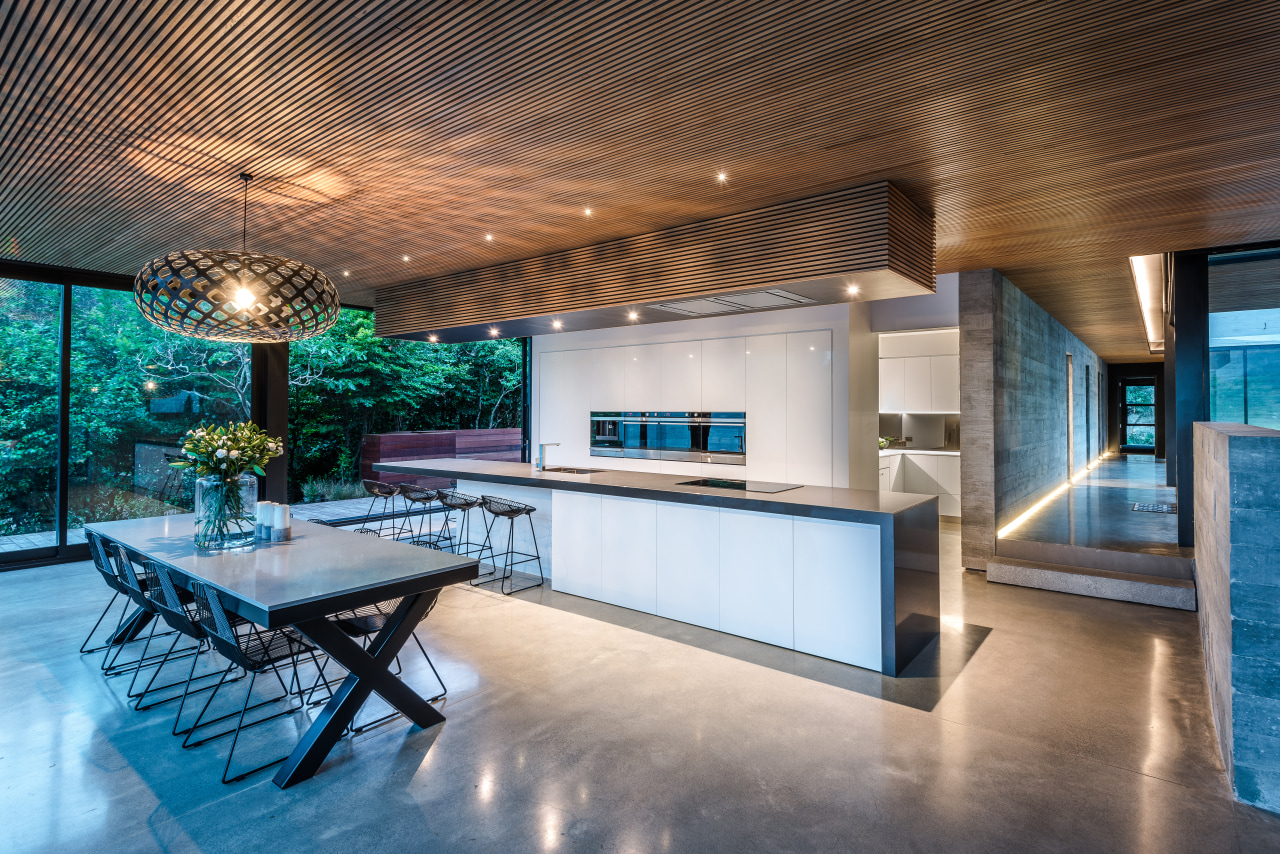This kitchen is the hub of the home architecture, building, ceiling, countertop, design, estate, floor, flooring, furniture, home, house, interior design, kitchen, lighting, loft, property, real estate, room, table, gray