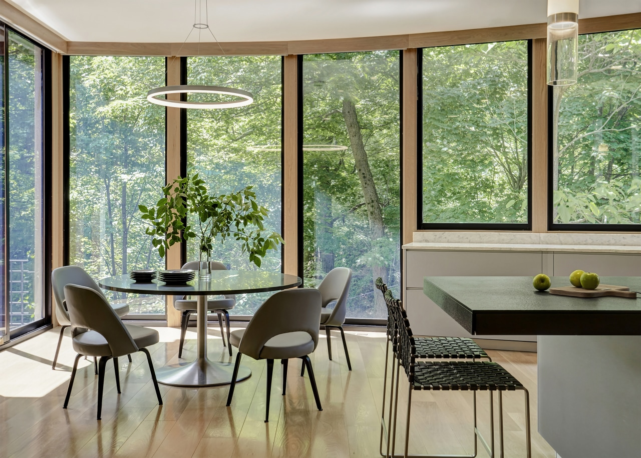 ​​​​​​​A curved wall of windows in the original architecture, building, ceiling, chair, daylighting, dining room, door, floor, furniture, glass, hardwood, home, house, interior design, property, room, shade, table, window, gray