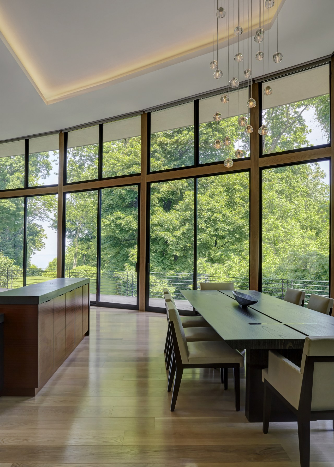 Like the kitchen in this renovated home, the architecture, building, ceiling, daylighting, design, dining room, door, floor, flooring, furniture, glass, hardwood, home, house, interior design, living room, property, real estate, room, sash window, shade, table, tree, window, wood, wood flooring, gray