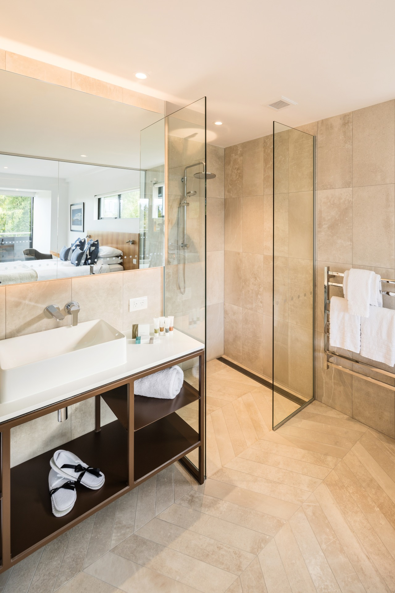 ​​​​​​​Clean-lined and contemporary, this custom steel-framed vanity is apartment, architecture, bathroom, beige, building, ceiling, floor, flooring, furniture, home, house, interior design, material property, plumbing fixture, property, real estate, room, tile, white, orange