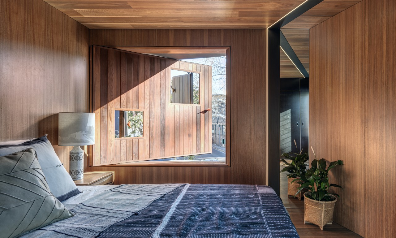 Overlooking the street, this bedroom needed to balance brown, gray