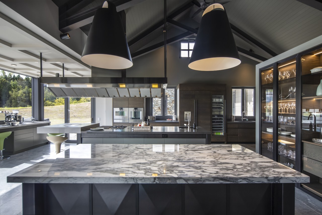 While both islands in this kitchen have an black, gray