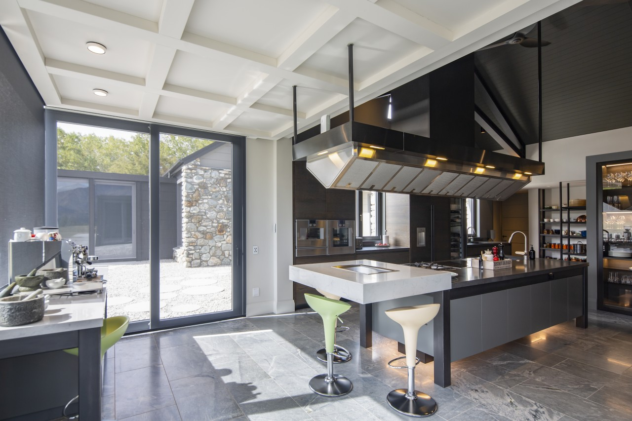 Set in a seemingly impossible cantilevered engineered stone gray, black