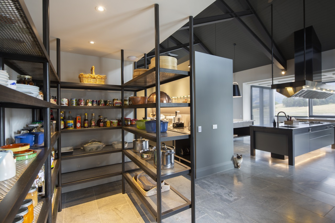 ​​​​​​​This kitchen's pantries are tucked out of sight gray, black