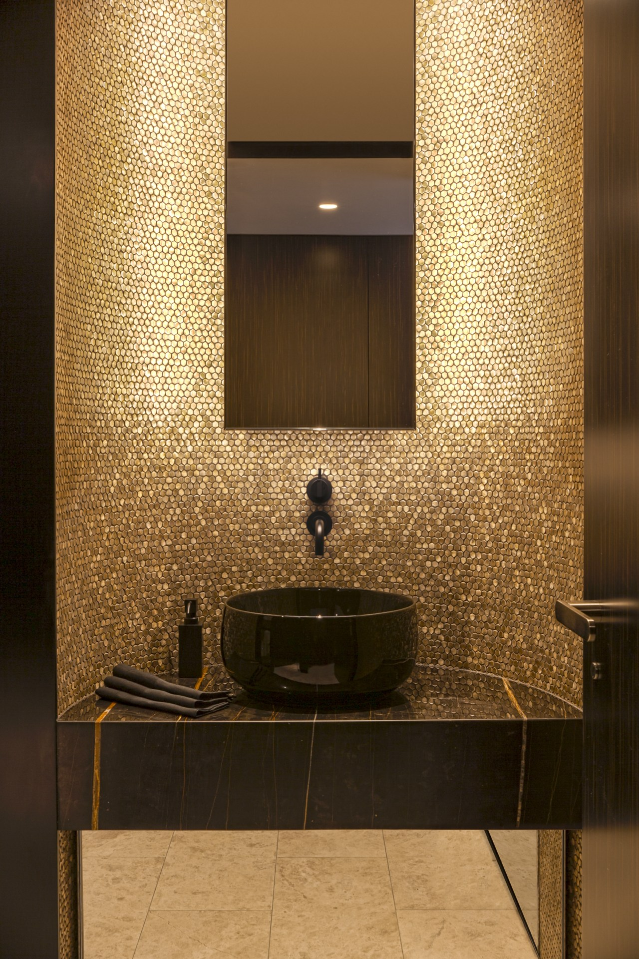 ​​​​​​​This luxurious powder room forms part of a brown, orange