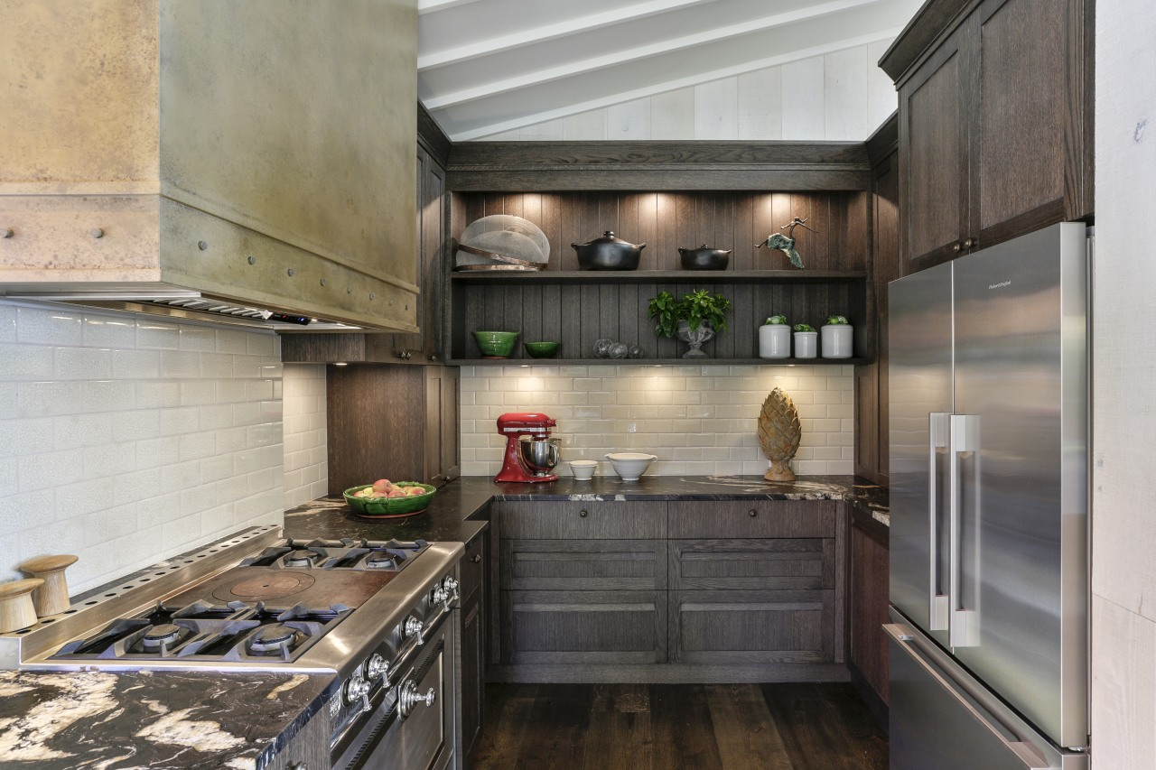 For this kitchen design by Shane George of gray, black