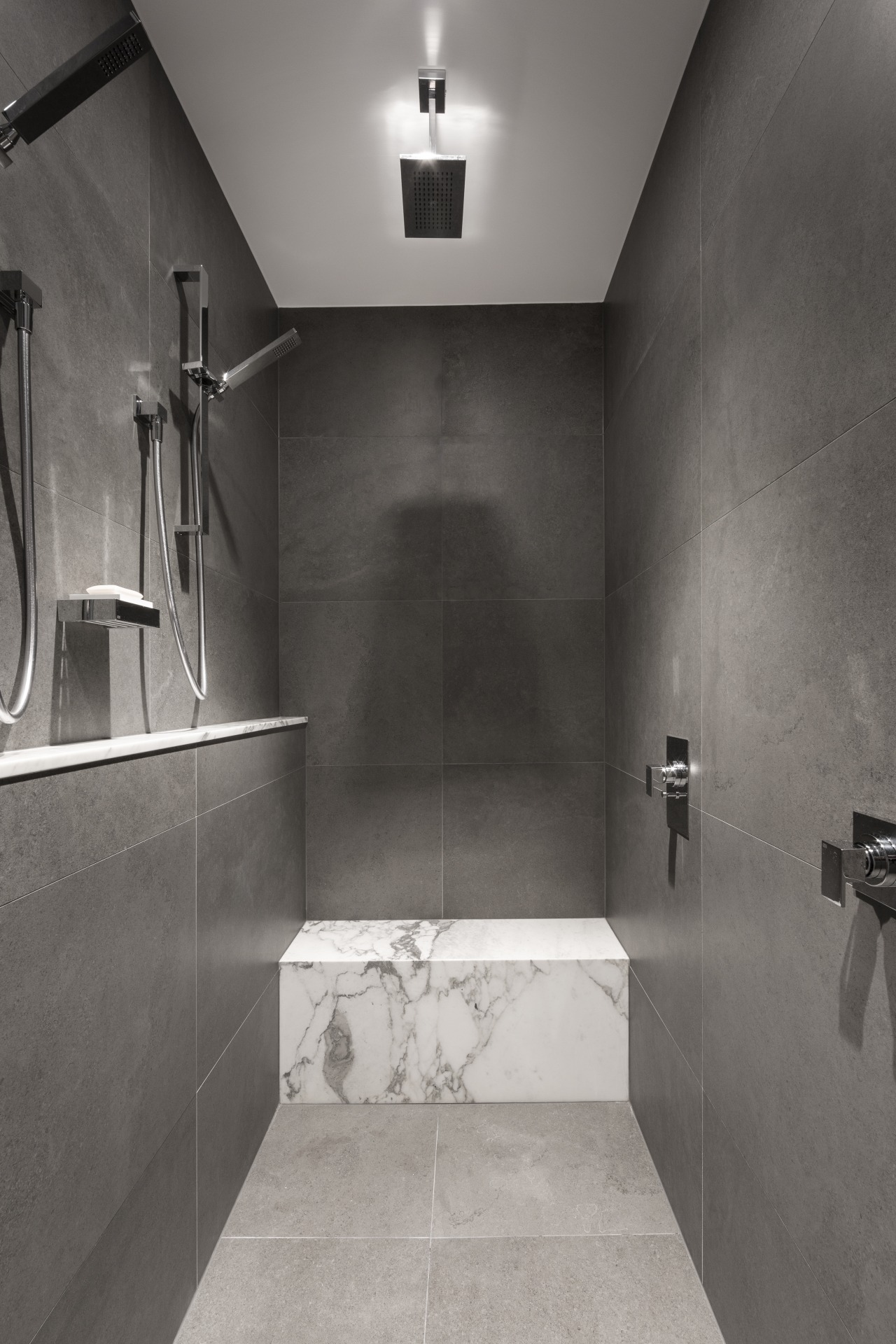 ​​​​​​​While this shower area is in predominantly grey gray, black