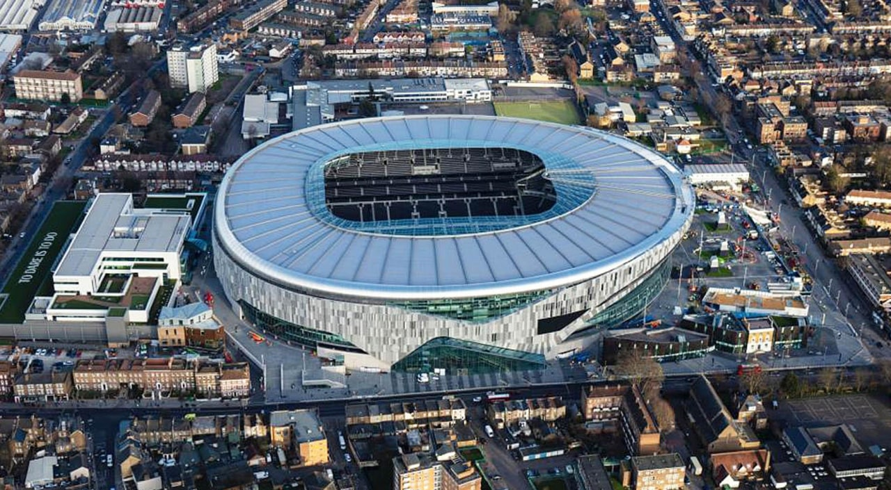 The new Tottenham Hotspur stadium offers diversification of aerial photography, architecture, arena, bird's-eye view, city, landscape, metropolitan area, soccer-specific stadium, sport venue, stadium, urban area, urban design, gray