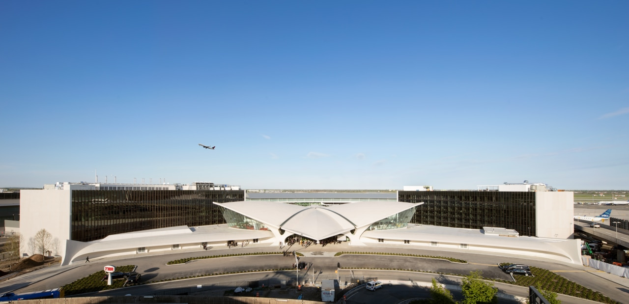 Two brand new wings behind Eero Saarinen's historic aerospace engineering, air travel, aircraft, airline, airliner, airplane, airport, airport apron, TWA Hotel