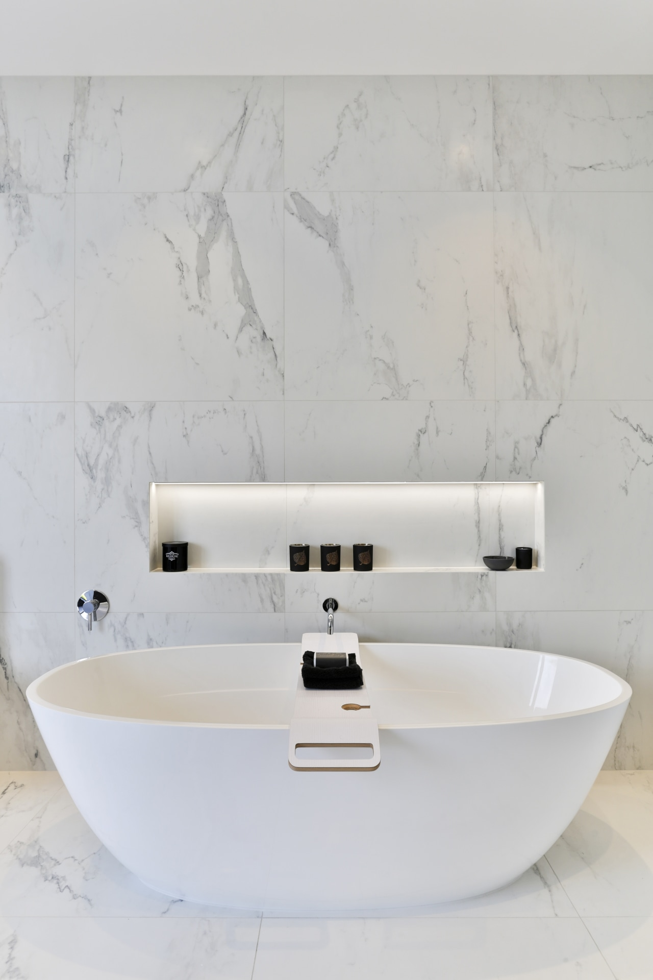 A freestanding tub adds a sculptural element to