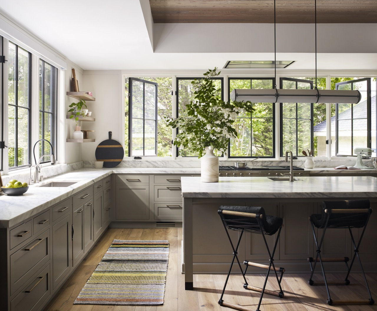 ​​​​​​​Marble benchtops, classic windows and traditional paneling all