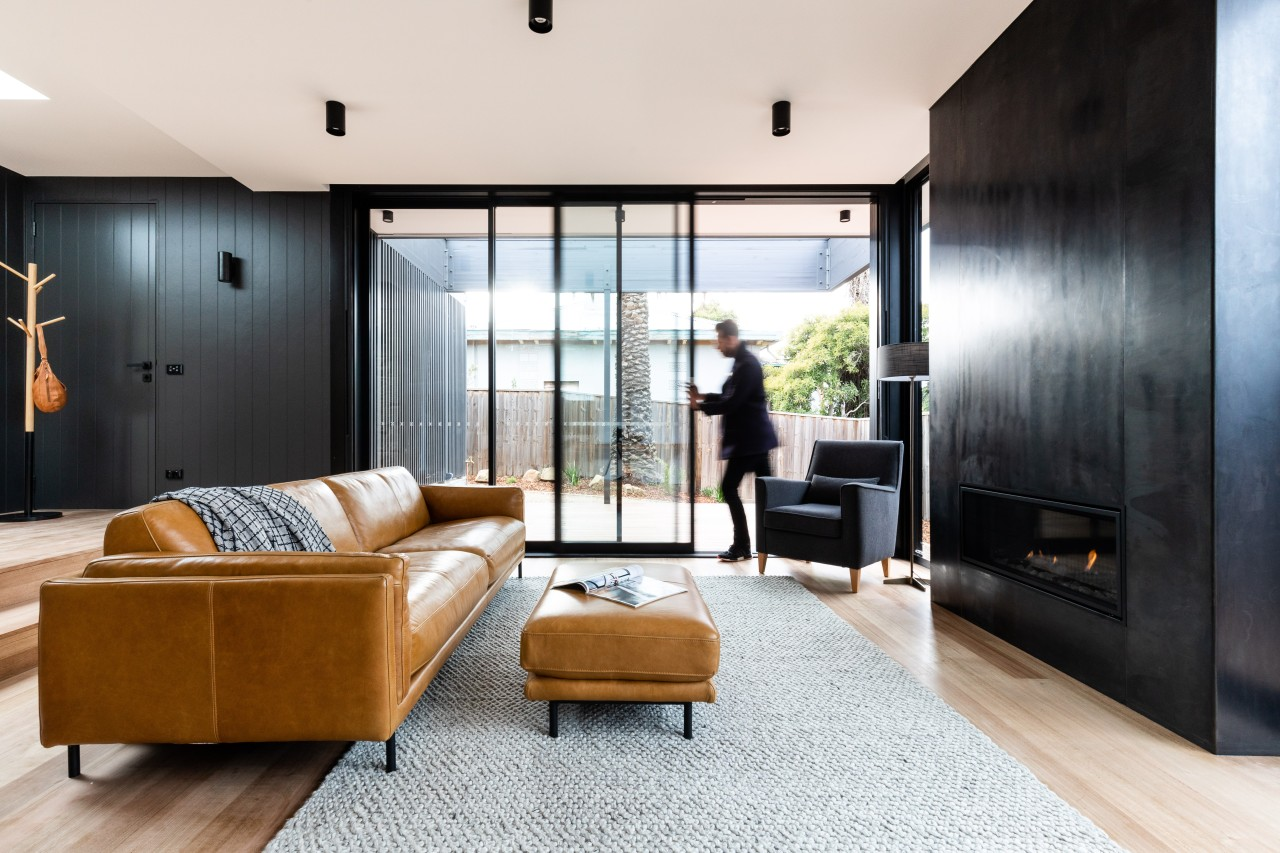 On this substantial renovation and expansion, floor-to-ceiling sliders white, black