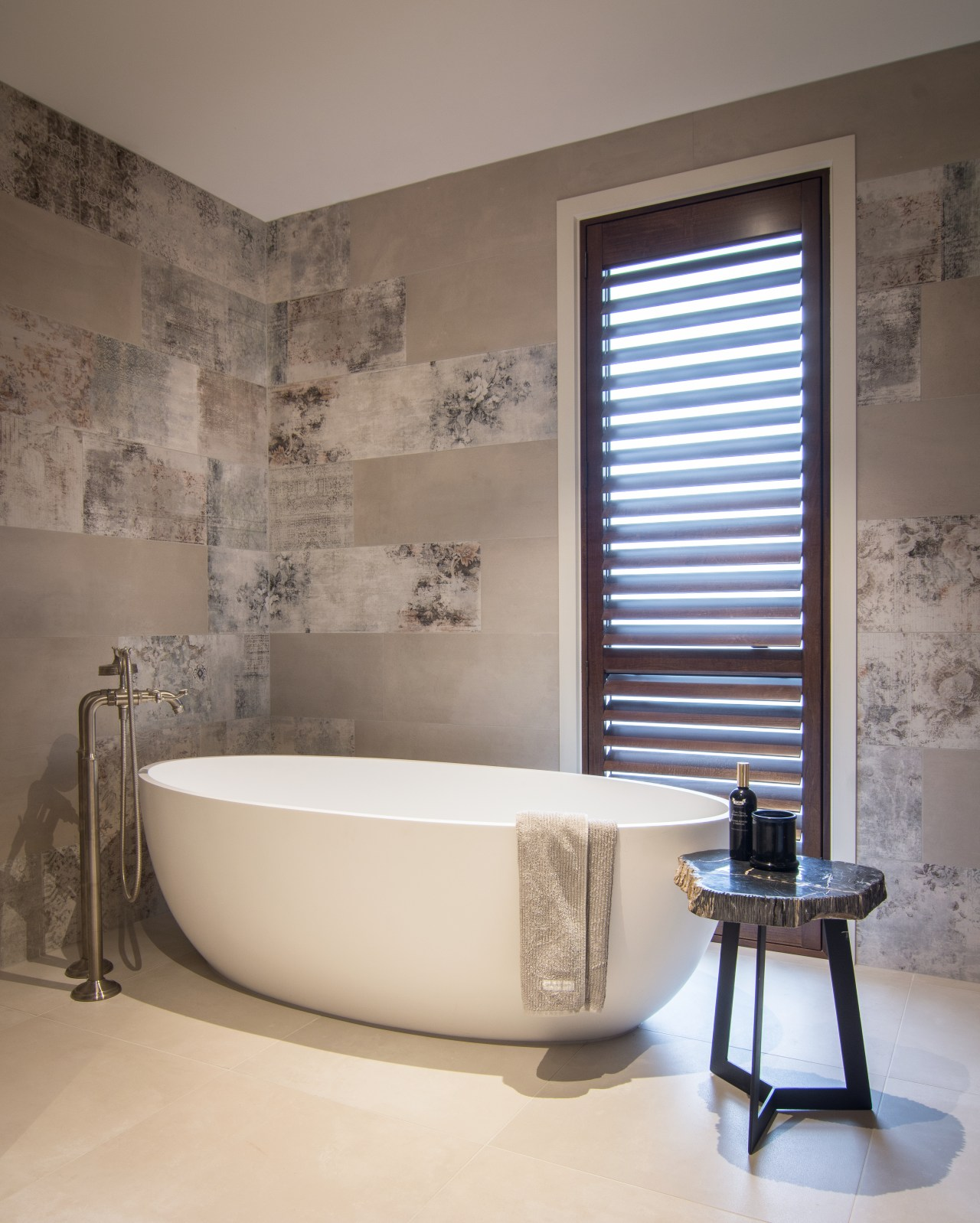 ​​​​​​​Large, distressed-look wall tiles add to the sense