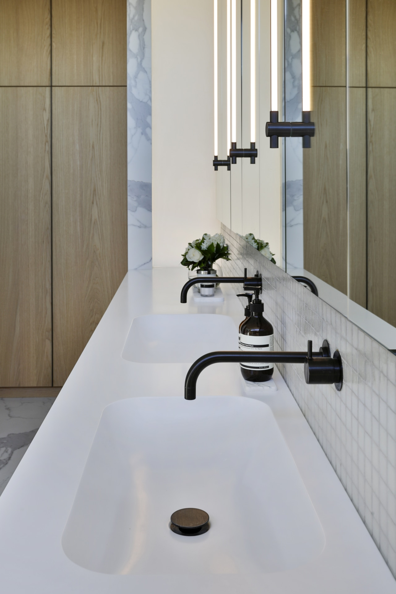 ​​​​​​​These mirror cabinet pulls feature LED strip lighting