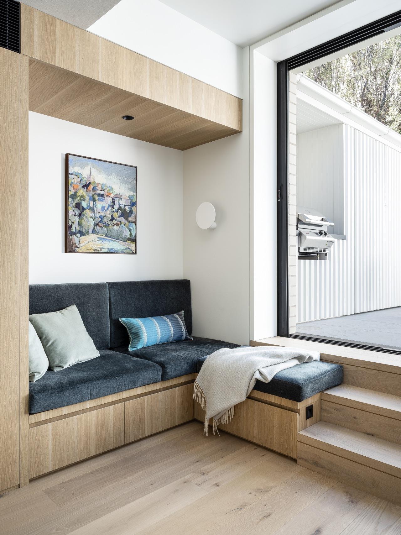 A comfy corner reading nook bathed in natural