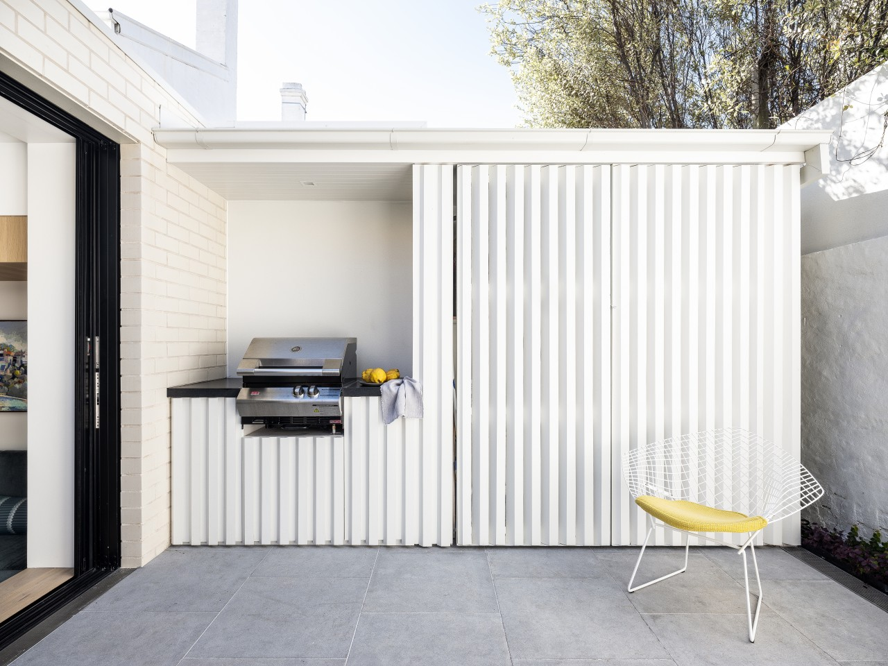 A newly introduced white-painted timber screen shed in