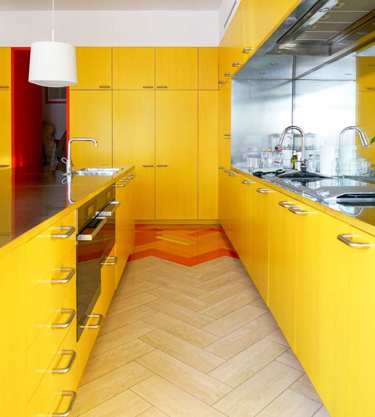 All the colours in the flat come from architecture, building, cabinetry, ceiling, countertop, floor, flooring, furniture, house, interior design, kitchen, material property, orange, property, room, tile, yellow, orange