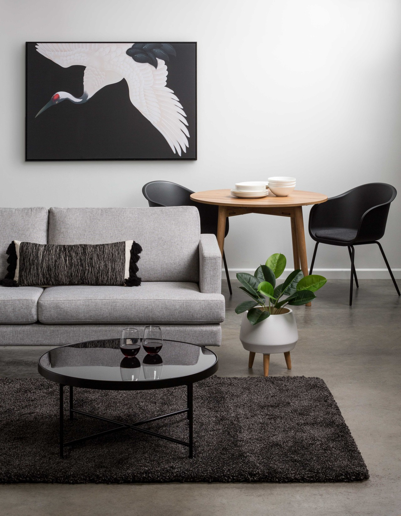 When choosing a rug think about how much black-and-white, chair, coffee table, couch, design, floor, furniture, houseplant, interior design, living room, plant, room, table, wall, white, black, gray