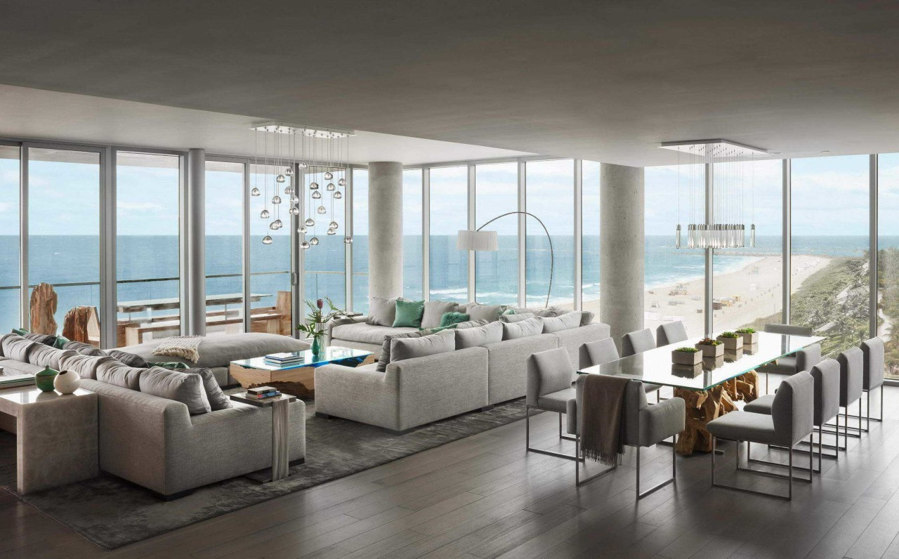 This penthouse elegantly tackles what is arguably the apartment, architecture, building, ceiling, coffee table, couch, daylighting, door, floor, flooring, furniture, home, house, interior design, living room, penthouse apartment, property, real estate, room, table, wall, window, gray