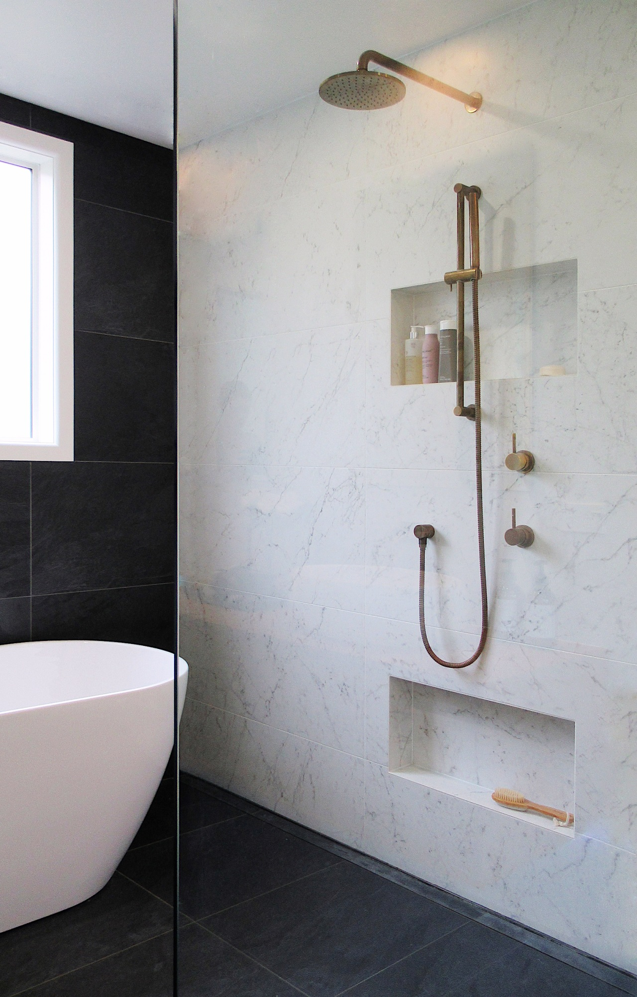 The living finish aged brass tapware is on-trend, gray