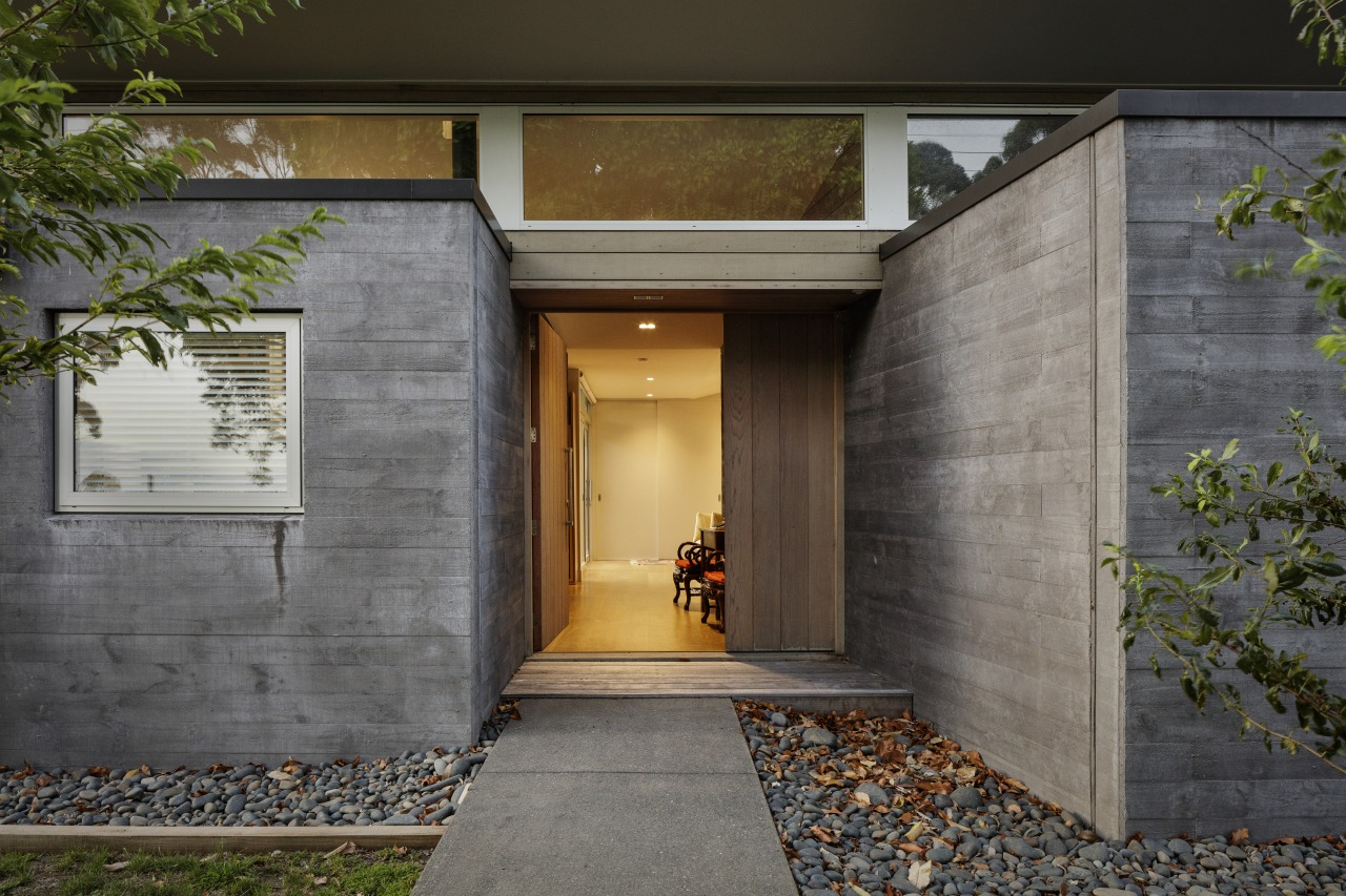 A tapered forced perspective view between concrete boxes architecture, building, concrete, door, estate, facade, cladding, home, house, interior design, property, real estate, residential area, tree, wall, yellow, gray, black