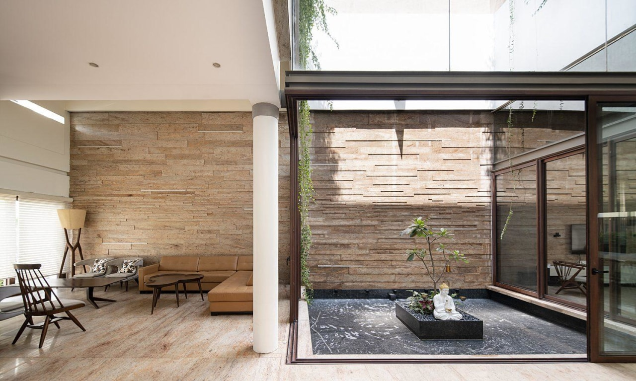 Breezes flow over the internal water feature, cooling