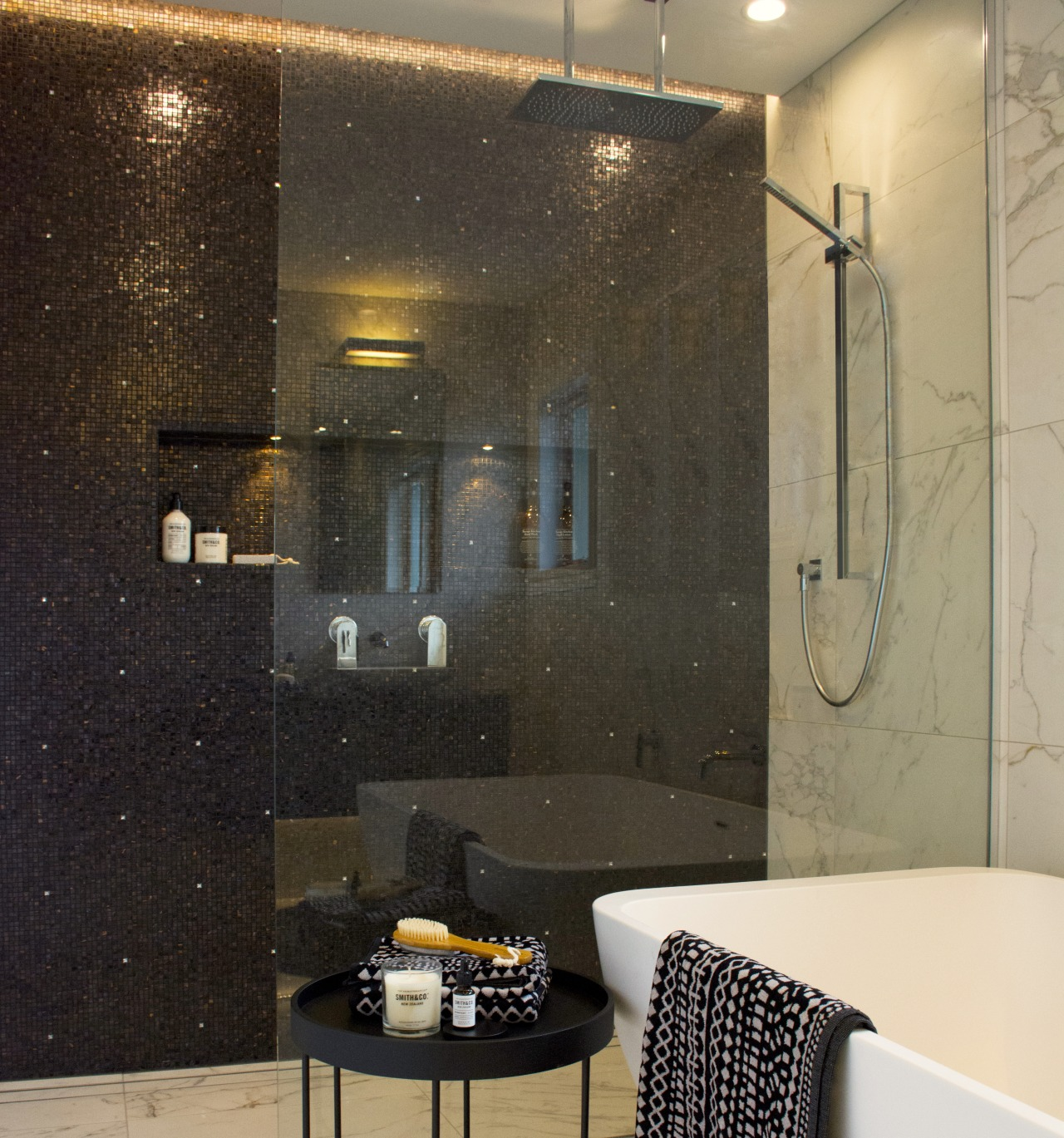 Black mosaics in the shower create contrast, and architecture, bathroom, bathroom accessory, building, ceiling, floor, flooring, furniture, glass, interior design, lighting, marble, plumbing fixture, property, room, shower, tap, tile, wall, black