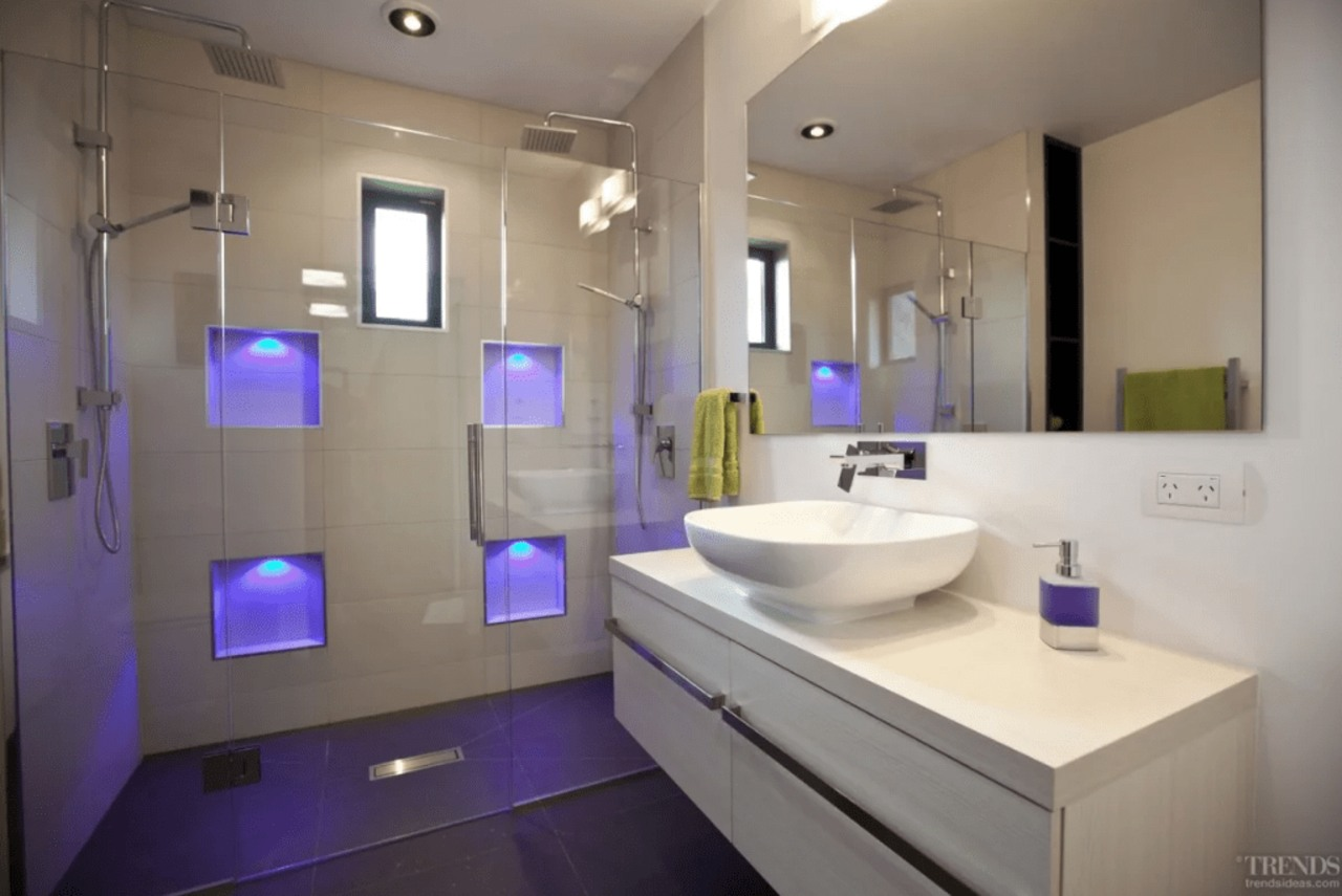 With LED strip lights hidden in the nooks bathroom, home, interior design, purple, real estate, room, sink, gray